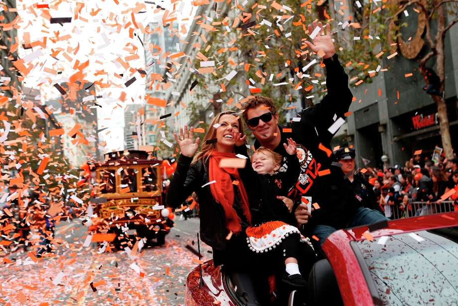 Giants pitcher Matt Cain, wife Chelsea and daughter Hartley wave during the World Series victory parade on Wednesday, October 31, 2012 in San Francisco, Calif. Photo: Beck Diefenbach, Special To The Chronicle / ONLINE_YES