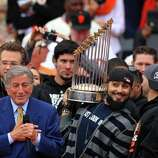 Sergio Romo hams it up behind Tony Bennett before the crowd at the World Series victory celebration, Wednesday Oct. 31, 201, in San Francisco, Calif.
