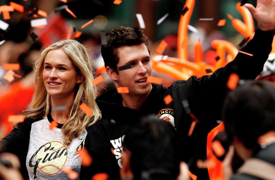 San Francisco Giants' Buster Posey and his wife Kristen wave to fans as the San Francisco Giants celebrate their World Series Championship with a parade up Market Street in downtown San Francisco, Calif., on Wednesday Oct. 31, 2012. Photo: Michael Macor, The Chronicle / ONLINE_YES