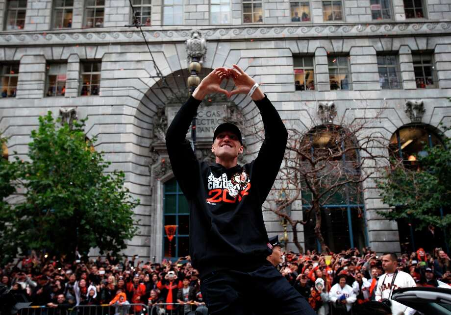 Hunter Pence makes a heart sign to the crowd during the San Francisco Giants World Series Parade in San Francisco, Calif., Wednesday, October 31, 2012. Photo: Sarah Rice, Special To The Chronicle / ONLINE_YES