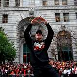 Hunter Pence makes a heart sign to the crowd during the San Francisco Giants World Series Parade in San Francisco, Calif., Wednesday, October 31, 2012.