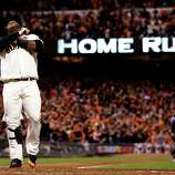 San Francisco Giants' Pablo Sandoval reacts at home after hitting his third home run of the game during the fifth inning of Game 1 of baseball's World Series against the Detroit Tigers Wednesday, Oct. 24, 2012, in San Francisco.