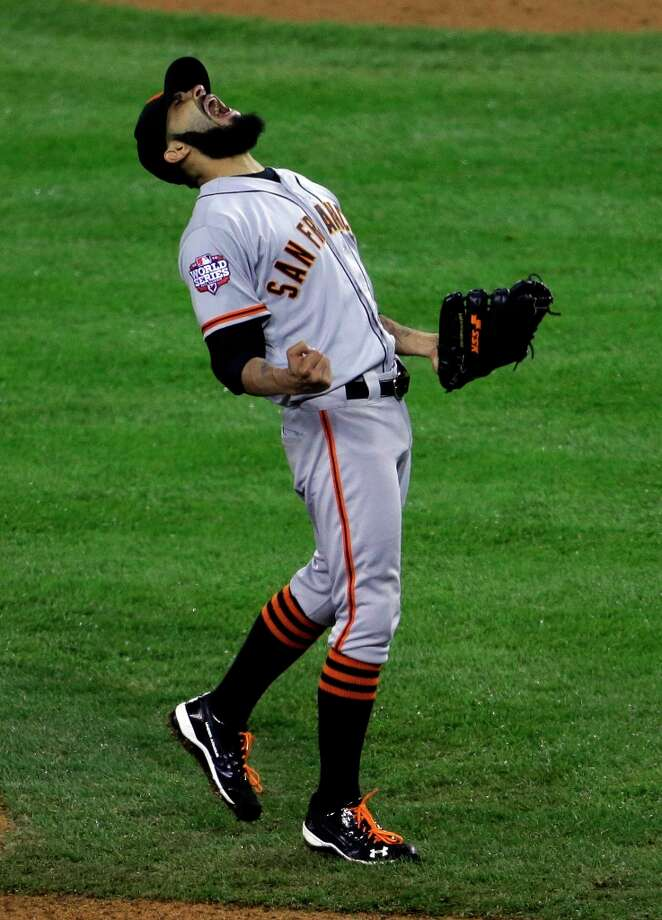 San Francisco Giants' Sergio Romo reacts after striking out Detroit Tigers' Miguel Cabrera in the 10th inning of Game 4 of baseball's World Series Sunday, Oct. 28, 2012, in Detroit. The Giants won the game 4-3 to win the World Series. Photo: Patrick Semansky, Associated Press / AP