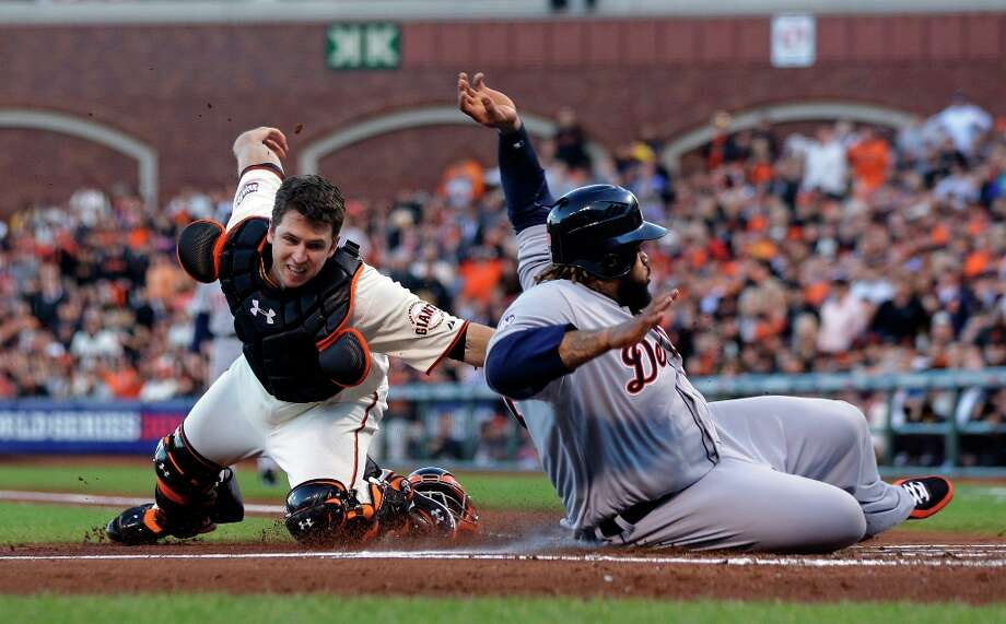 Detroit Tigers' Prince Fielder is tagged out at home plate by San Francisco Giants' Buster Posey during the second inning of Game 2 of baseball's World Series Thursday, Oct. 25, 2012, in San Francisco. Photo: Marcio Jose Sanchez, Associated Press / AP