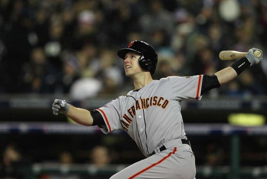 Giants' catcher Buster Posey watches his 2-run homer in the 6th inning during game 4 of the World Series at Comerica Park on Sunday, Oct. 28, 2012 in Detroit, MI. Photo: Lance Iversen, The Chronicle / ONLINE_YES