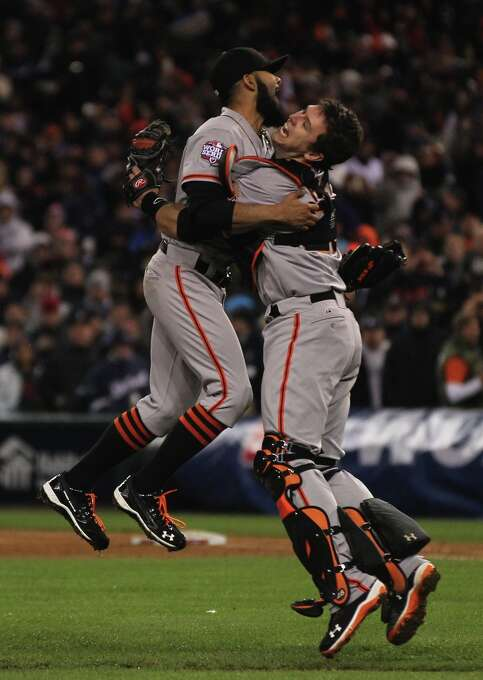 San Francisco Giants Sergio Romo and Buster Posey celebrate their World Series win over the Detroit Tigers at Comerica Park in Detroit, Mi., Sunday, Oct. 28, 2012. Photo: Lance Iversen, The Chronicle / ONLINE_YES