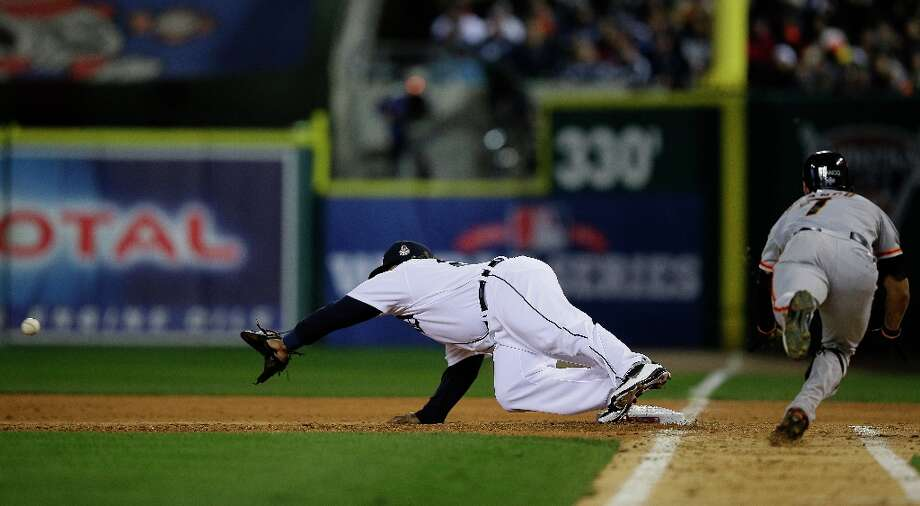 San Francisco Giants right fielder Gregor Blanco slides into the first base as Detroit Tigers first baseman Prince Fielder reaches for the ball to force Blanco out during the seventh inning of Game 3 of baseball's World Series Saturday, Oct. 27, 2012, in Detroit. Photo: Matt Slocum, Associated Press / AP