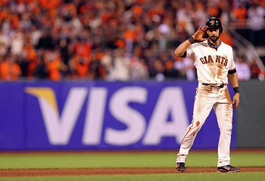 Angel Pagan #16 of the San Francisco Giants reacts after he stole second base in the eighth inning against the Detroit Tigers during Game Two of the Major League Baseball World Series at AT&T Park on October 25, 2012 in San Francisco, California. Photo: Christian Petersen, Getty Images / 2012 Getty Images