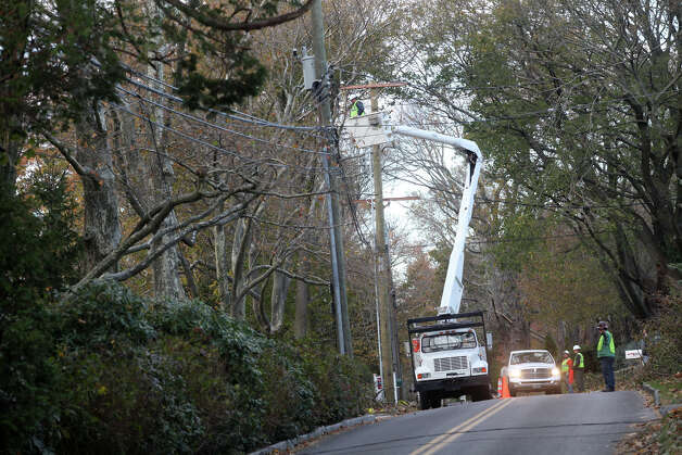 A utility truck from Georgia repairs power lines on Sasco Hill Rd. in Fairfield, Conn. on Sunday, November 4, 2012. Photo: BK Angeletti, B.K. Angeletti / Connecticut Post freelance B.K. Angeletti