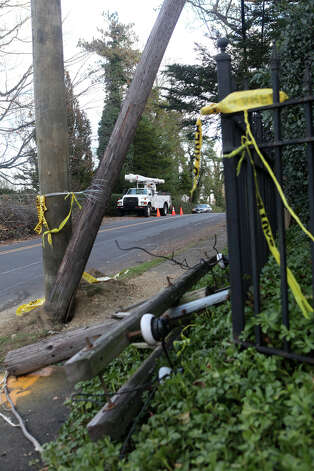 A utility truck repairs power lines after storm Sandy on Old Field Rd. in Fairfield, Conn. on Sunday, November 4, 2012. Photo: BK Angeletti, B.K. Angeletti / Connecticut Post freelance B.K. Angeletti