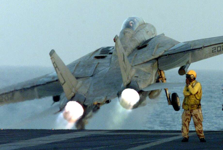 An F-14 takes off from the main deck of the USS Enterprise on October 9, 2001 as a second wave U.S.-led air attacks on Afghanistan was launched. Photo: RABIH MOGHRABI, AFP/Getty Images / 2011 AFP