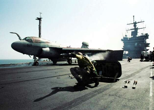 An EA-6B Prowler electronic countermeasures aircraft is catapulted from the USS Enterprise on October 9, 2001, during Operation Enduring Freedom. Photo: U.S. Navy, Getty Images / Getty Images North America