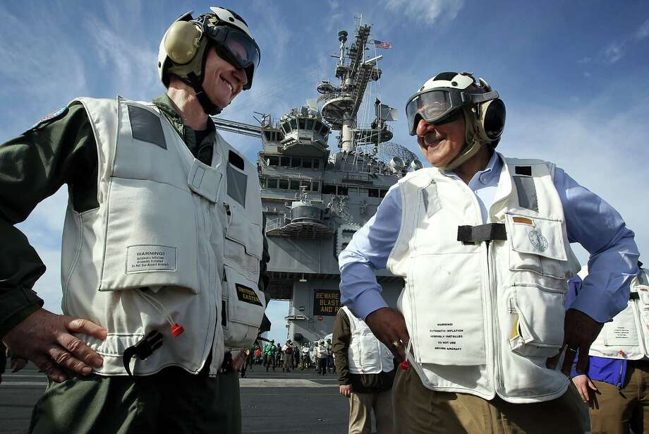 U.S. Secretary of Defense Leon E. Panetta (right), escorted by Commander of Strike Group Twelve Rear Admiral Walter E. Carter, Jr., watches day flight operations from the flight deck of the USS Enterprise on January 21, 2012 off of the southeastern coast of the United States. Photo: Getty Images
