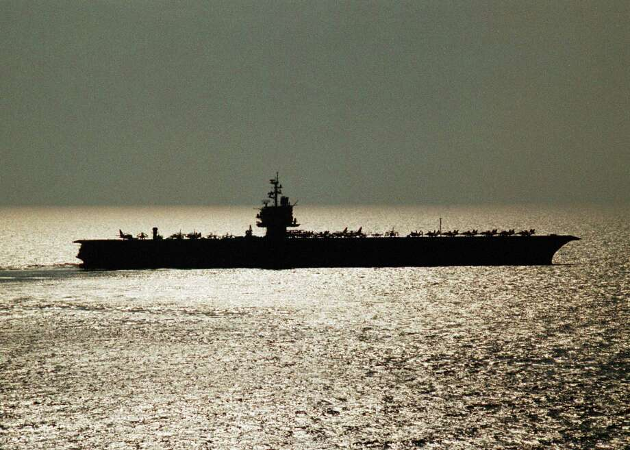 The USS Enterprise is silhouetted in the late afternoon sun in the Persian Gulf December 02, 1998. Photo: U.S. Navy, Getty Images / Getty Images North America