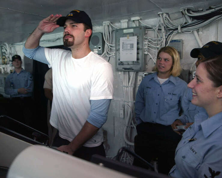Actor Ben Affleck entertains the crew of the USS Enterprise in the Persian Gulf on December 22, 2003
