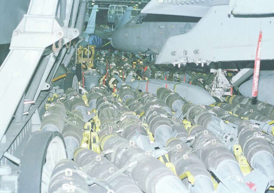Ordnance fills a hangar bay of the USS Enterprise on Dec. 18, 1998. Photo: U.S. Navy, Getty Images / Getty Images North America