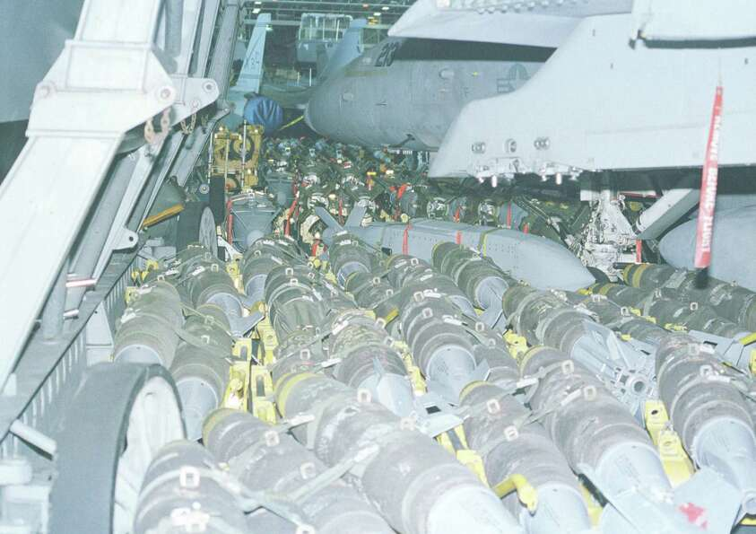 Ordnance fills a hangar bay of the USS Enterprise on Dec. 18, 1998.