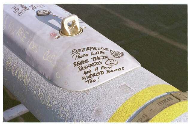 The professional photographers of the USS Enterprise photo lab send their regards to Saddam Hussein on a piece of ordnance to be used in the third wave of air strikes against Iraq in this photo from December 18, 1998. Photo: U.S. Navy, Getty Images / Getty Images North America
