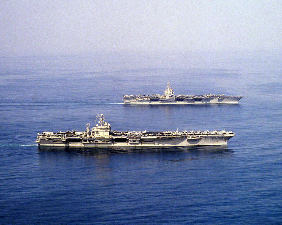 The aircraft carriers USS Enterprise (top) and Carl Vinson meet briefly in the waters of the Persian Gulf on September 16, 2001. Photo: U.S. Navy, Getty Images / Getty Images North America