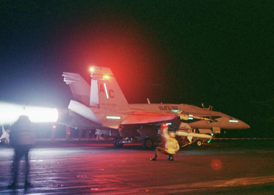 An F/A-18C Hornet awaits the signal from flight deck personnel prior to launch from the deck of the USS Enterprise on December 18, 1998 in the Persian Gulf. Photo: U.S. Navy, Getty Images / Getty Images North America