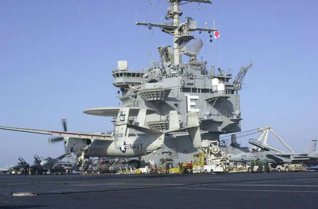 An E-2C Hawkeye lands on the USS Enterprise on October 20, 2001, during Operation Enduring Freedom. Photo: U.S. Navy, Getty Images / Getty Images North America