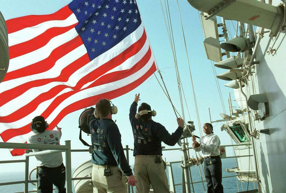 U.S. Navy personnel raise the American flag aboard the USS Enterprise on October 20, 2001 during Operation Enduring Freedom. This flag flew over the Arlington (Va.) Fire Department command post at the Pentagon following the September 11, 2001, terrorist attack there. Photo: U.S. Navy, Getty Images / Getty Images North America