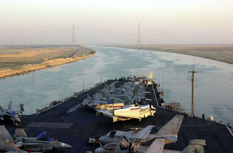 The  bow of the USS Enterprise is seen from the navigation bridge on October 28, 2001, as the ship heads into the Suez Canal. Photo: U.S. Navy, Getty Images / Getty Images North America
