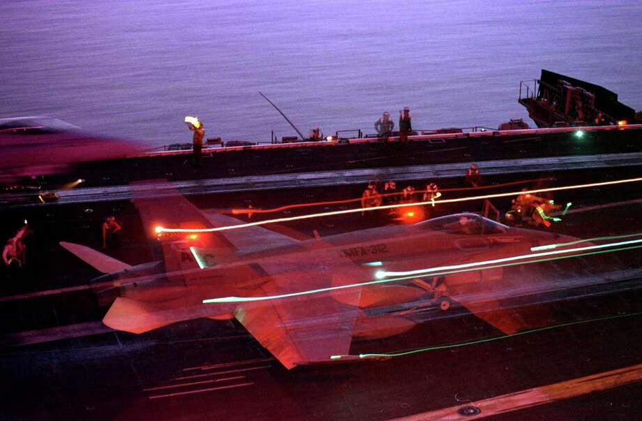 A U. S. Marine Corps F/A-18 Hornet leaves trails of light in this time exposure as it launches at night from the flight deck of the USS Enterprise Nov. 25, 1998 in the Persian Gulf in support of Operation Southern Watch. Photo: U.S. Navy, Getty Images / Getty Images North America