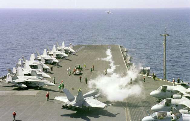 Steam rises from the number one catapult aboard USS Enterprise as an F/A-18C Hornet launches from the bow during intense flight operations March 9, 1999 in the Mediterranean Sea. Photo: U.S. Navy, Getty Images / Getty Images North America