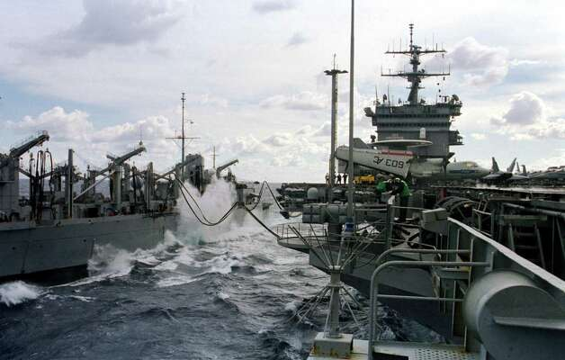 USS Enterprise battles high seas while taking on stores during an underway replenishment with the USS Detroit in the Adriatic Sea in 1999. Photo: U.S. Navy, Getty Images / Getty Images North America