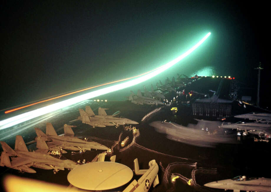 A jet takes-off from the flight deck of the USS Enterprise in the Arabian Sea on October 11, 2001. Photo: JOCKEL FINCK, AFP/Getty Images / AFP