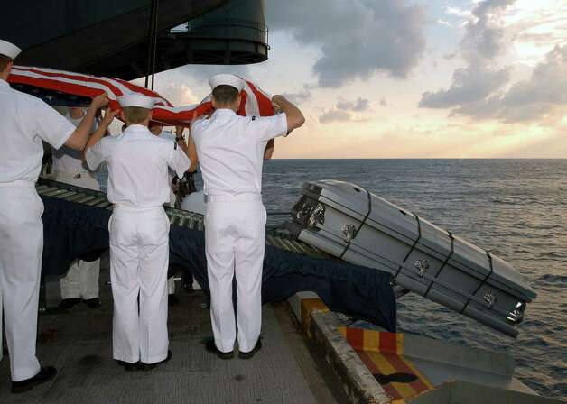 U.S. Navy sailors perform a burial at sea ceremony for U.S. Navy Machinist's Mate Third Class Nathan Taylor on the the USS Enterprise May 19, 2004, in this photo released by the Pentagon April 28, 2005. Photo: DOD, Getty Images / 2005 Department of Defense