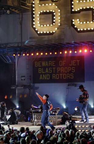 Country singer Garth Brooks and his band perform on the flight deck of the USS Enterprise while docked at its home port, in Va., on November 21, 2001. Photo: Gary Knapp, Getty Images / Getty Images North America