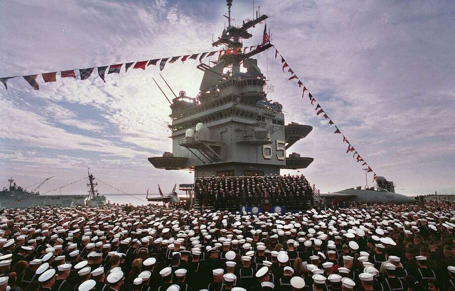 U.S. President George W. Bush speaks to a crowd of about 10,000 on the flight deck of the aircraft carrier USS Enterprise at Naval Station Norfolk December 7, 2001 in Norfolk, Va. Photo: Mike Heffner, Getty Images / Getty Images North America