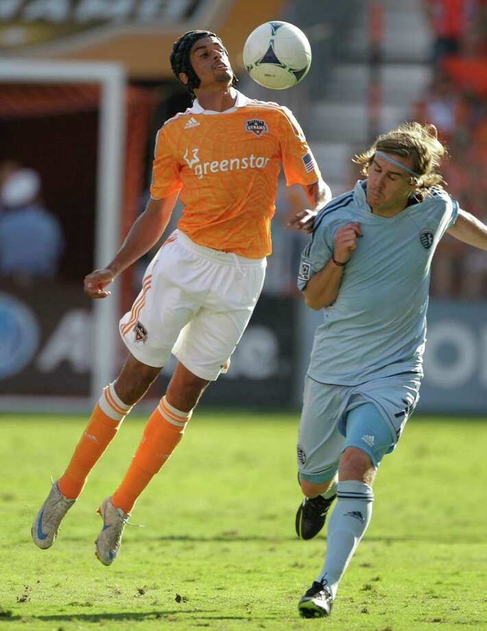 Houston Dynamo Calen Carr, left, and Sporting Kansas City Chance Myers, right, battle for the ball during the MLS Eastern Conference semifinal at the BBVA Compass Stadium Sunday, Nov. 4, 2012, in Houston. Photo: Melissa Phillip, Houston Chronicle / © 2012 Houston Chronicle