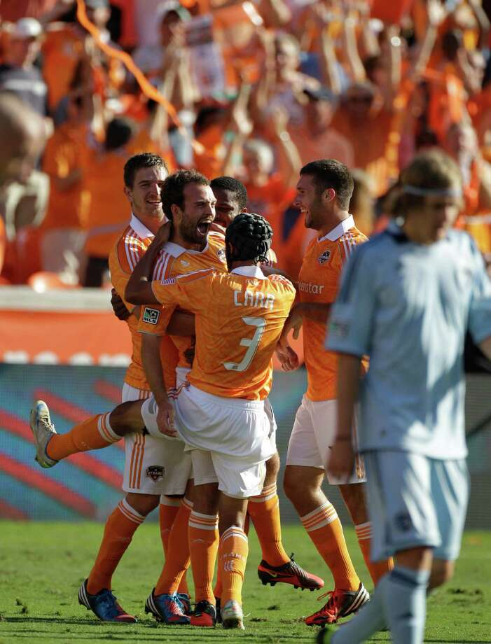Houston Dynamo Adam Moffat, left center, celebrates his goal with teammate (3) Calen Carr during first half against the the Sporting Kansas City in the MLS Eastern Conference semifinal at the BBVA Compass Stadium Sunday, Nov. 4, 2012, in Houston. Photo: Melissa Phillip, Houston Chronicle / © 2012 Houston Chronicle