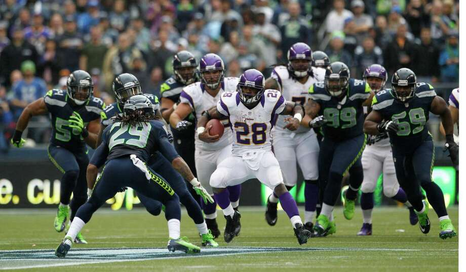Minnesota Vikings' Adrian Peterson (28) rushes with the ball as he faces off against Seattle Seahawks' Earl Thomas (29 in the first half of an NFL football game, Sunday, Nov. 4, 2012, in Seattle. Photo: AP