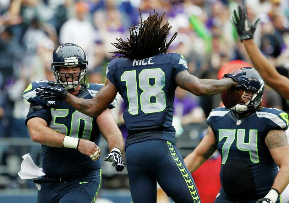 Seattle Seahawks' Sidney Rice (18) celebrates his touchdown against the Minnesota Vikings with teammates Max Unger (60) and John Moffitt (74) during the first half of an NFL football game, Sunday, Nov. 4, 2012, in Seattle. Photo: AP