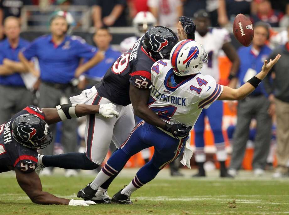 Texans rookie Whitney Mercilus applies pressure to Bills quarterback Ryan Fitzpatrick. (Nick de la Torre / Houston Chronicle)