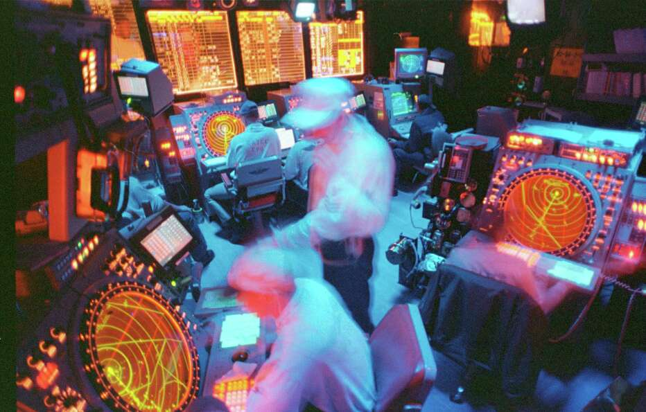 Air traffic controllers work aboard the USS Enterprise on December 16, 1998 in the Persian Gul.
