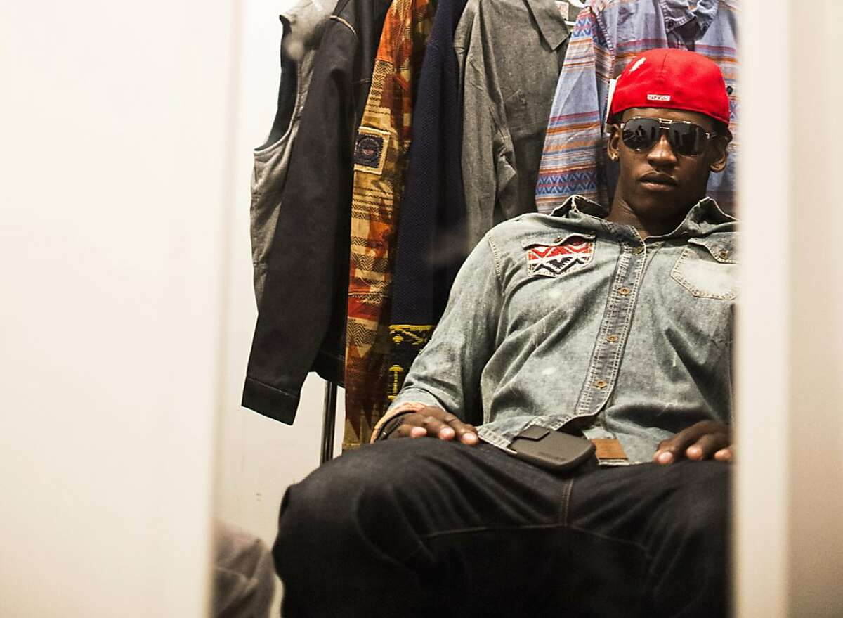 49ers linebacker Aldon Smith, tries on hats and sunglasses recommended by