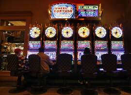 GAMBLING_89210.JPG three unidentified gamblers play the Wheel of Fortune progressive game with a jackpot of almost 1.5 million dollars. Thunder Valley Casino, east of Sacramento outside Lincoln is the 5th-biggest casino in the United States (including Vegas), The United Auburn Indian Community is about to embark on a new project a hotel tower fashioned after similar Four Season deigns. Once built adding more gaming space and restaurants and the hotel it will stand alone as the largest Northern California's casino. Lance Iversen/San Francisco Chronicle (cq) SUBJECT 12/04/07,in PLACER CO Ca.   Ran on: 12-07-2007 Three gamblers try their luck on the slots at the Thunder Valley casino, in Lincoln (Placer County), which is not part of the ballot measures. Ran on: 12-07-2007 Three gamblers try their luck on the slots at the Thunder Valley casino, in Lincoln (Placer County), which is not part of the ballot measures. Ran on: 12-07-2007 Three gamblers try their luck on the slots at the Thunder Valley casino, in Lincoln (Placer County), which is not part of the ballot measures. Ran on: 12-07-2007 Three gamblers try their luck on the slots at the Thunder Valley casino, in Lincoln (Placer County), which is not part of the ballot measures.