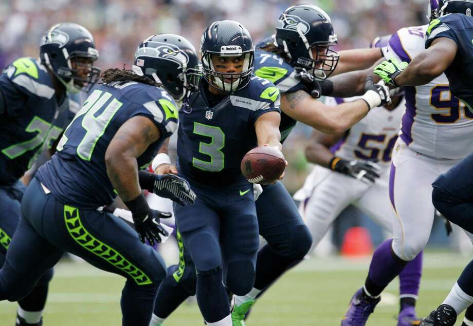 Seattle Seahawks quarterback Russell Wilson hands off to Marshawn Lynch (24) during the first half of an NFL football game against the Minnesota Vikings, Sunday, Nov. 4, 2012, in Seattle. Photo: AP