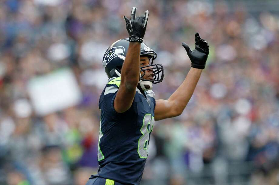 Seattle Seahawks' Golden Tate celebrates his first touchdown of an NFL football game against the Minnesota Vikings, Sunday, Nov. 4, 2012, in Seattle. Photo: AP