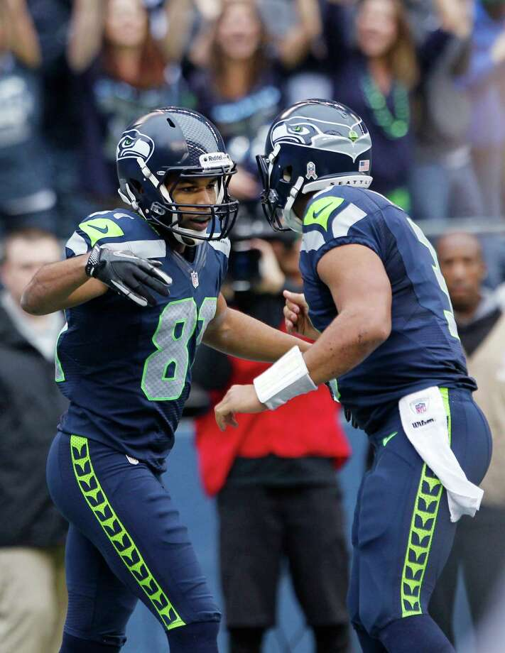 Seattle Seahawks' Golden Tate, left, celebrates his first touchdown of an NFL football game against the Minnesota Vikings, with Seahawks quarterback Russell Wilson, right, Sunday, Nov. 4, 2012, in Seattle. Photo: AP