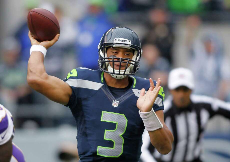 Seattle Seahawks quarterback Russell Wilson passes against the Minnesota Vikings in the first half of an NFL football game, Sunday, Nov. 4, 2012, in Seattle. Photo: AP