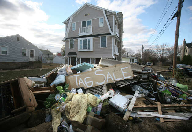 Items destroyed by the flood waters of Hurricane Sandy are piled outside a home on Fairfield Beach Road in Fairfield on Sunday, November 4, 2012. Photo: Brian A. Pounds / Connecticut Post