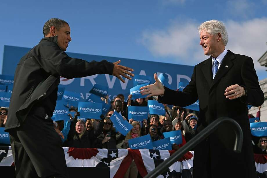 President Obama (left) is welcomed by former President Bill Clinton at a rally in Concord, N.H. Photo: Chip Somodevilla, Getty Images