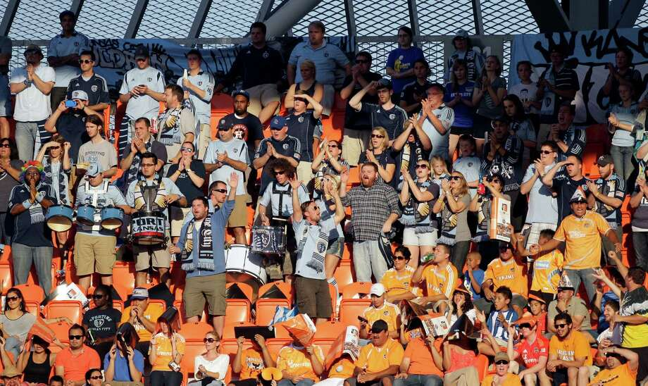 Sporting Kansas City  fans cheers during the MLS Eastern Conference semifinal against Houston Dynamo at the BBVA Compass Stadium Sunday, Nov. 4, 2012, in Houston. Photo: Melissa Phillip, Houston Chronicle / © 2012 Houston Chronicle