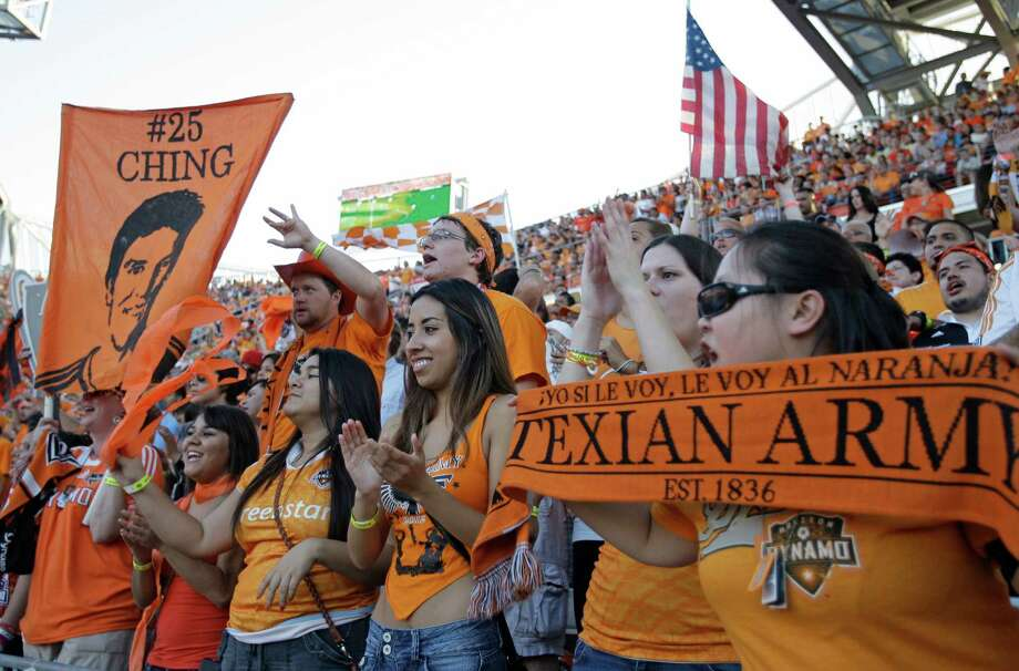 Houston Dynamo fans cheers during the MLS Eastern Conference semifinal against Sporting Kansas City at the BBVA Compass Stadium Sunday, Nov. 4, 2012, in Houston. Photo: Melissa Phillip, Houston Chronicle / © 2012 Houston Chronicle